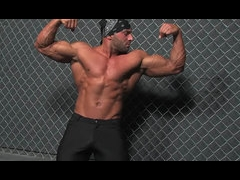 A horny bodybuilder jerking off outside