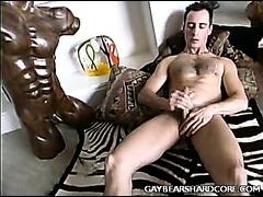 Hot gay stud jerking off alone on a bearskin rug