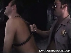 A horny cop forces a hot leather boy to fuck