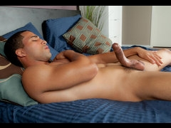 A horny light-skinned black man masturbating