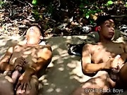 Excited black gay thugs jerk off outdoors