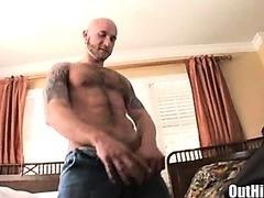 A hot tattooed muscular stud jerking off alone