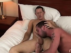 A horny amateur getting his cock sucked in a hotel room