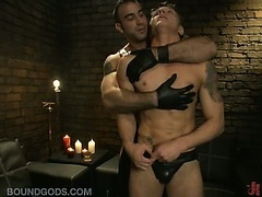 Hot bondage scene with two nasty leather daddies