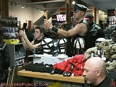 A hot group of guys hanging out in a fantasy adult bookstore